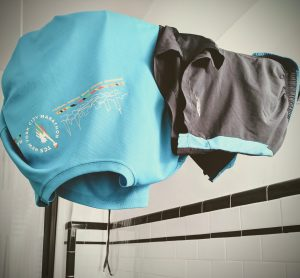 running kit drying on the shower rail