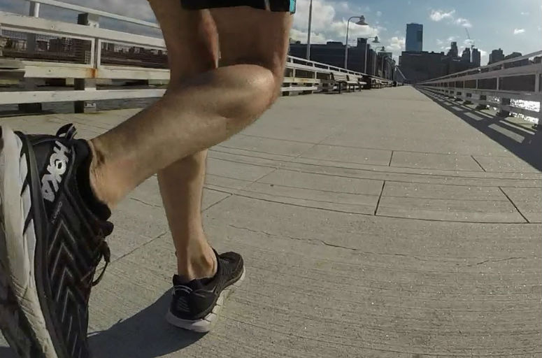 Ground level view of a runner showing only the moving legs
